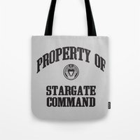 stargate Tote Bags featuring Property of Stargate Command Athletic Wear Black ink by RockatemanDesigns
