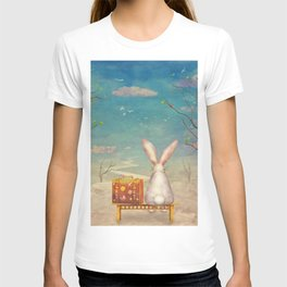 Sad rabbit  with suitcase sitting on the bench on the cloud in sky  T-shirt