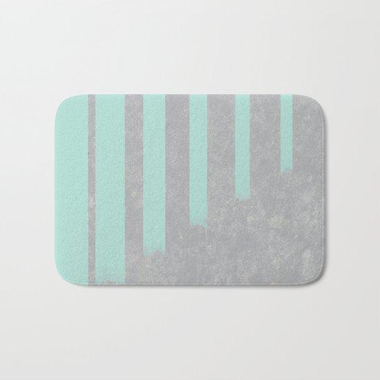 Soft cyan stripes on concrete Bath Mat