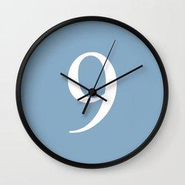 number nine sign on placid blue color background Wall Clock