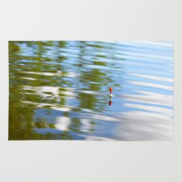 Fishing float on the water Rug