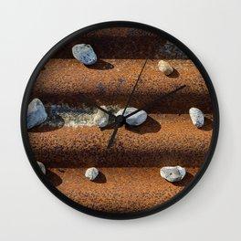 Pebbles on rust Wall Clock