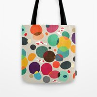 koi Tote Bags featuring Lotus in koi pond by Picomodi