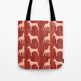 Red wooden board with dobermans shapes Tote Bag