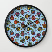 sugar skulls Wall Clocks featuring Sugar Skulls by Kara Peters