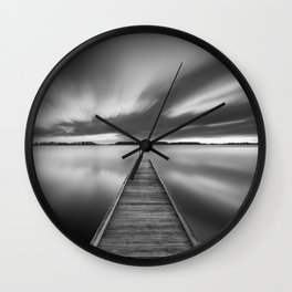 Jetty on a lake in black and white Wall Clock