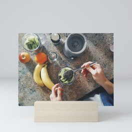 Preparing a healthy smoothie Mini Art Print
