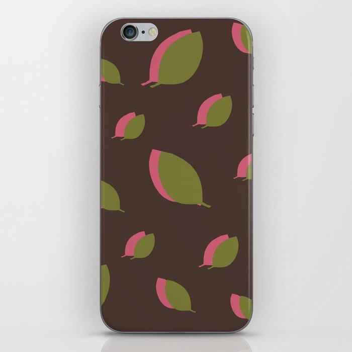 Green pink leaves on brown iPhone Skin