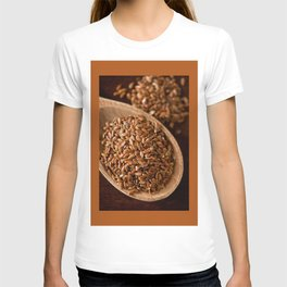 Brown flax seeds portion on wooden spoon T-shirt