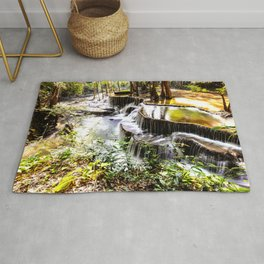 waterfall in forest landscape Rug