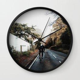 climbing the hill on road bike Wall Clock