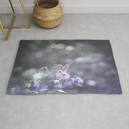 Sun rays and bokeh effect over the butterfly Rug