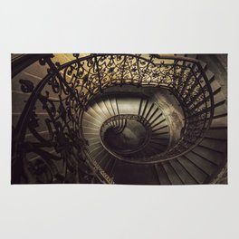 Spiral staircase in brown and golden tones Rug