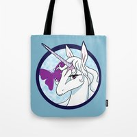 the last unicorn Tote Bags featuring Last Unicorn by AriesNamarie