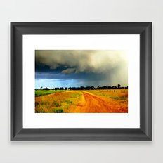 Tracking a Storm Framed Art Print