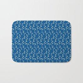 Doodle flowers on blue Bath Mat