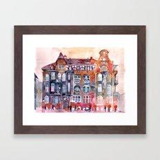 Apartment House in Poznan and orange umbrellas Framed Art Print
