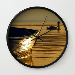 Rowing boat and swan sunset reflections Wall Clock