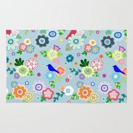 Whimsical Spring Flowers in Blue Rug
