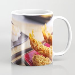 Shrimp tempura and various Japanese sushi on a plate Coffee Mug