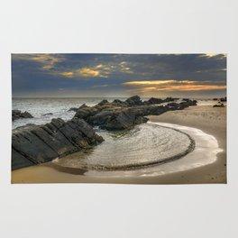 Windy Tarifa beach. Wild swiming pools. Rug