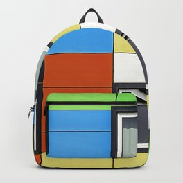 Facade with colorful paintings and windows Backpack