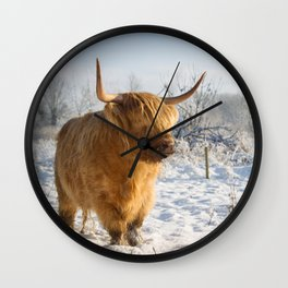 Highland Cow in the snow Wall Clock