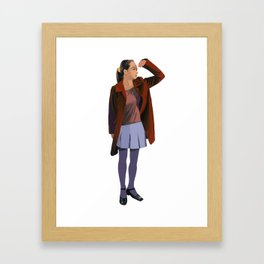 A woman with a red coat Framed Art Print