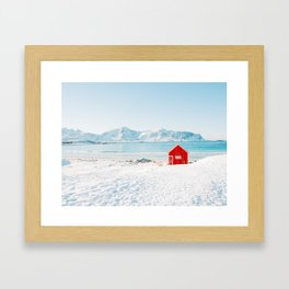 Red cabin on the beach with snow in the Lofoten Islands, Norway Framed Art Print