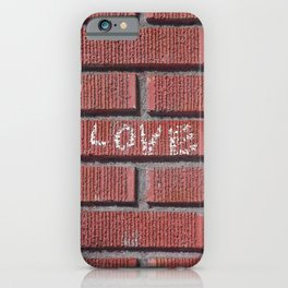 Love on a Brick Wall iPhone Case