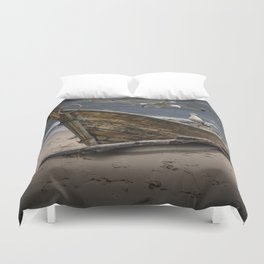 Gulls Flying over a Shipwrecked Wooden Boat Duvet Cover