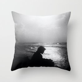 B&W film generated photo of a silhouette of an artist drawing the waves Throw Pillow