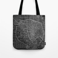 paris map Tote Bags featuring Paris map by Le petit Archiviste