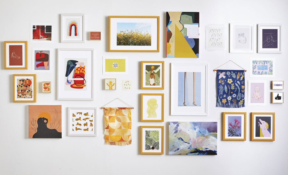gallery wall with colorful framed art prints