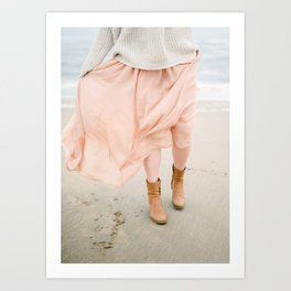 Coastal photography of a woman holding her flowy skirt at the beach. Pastel colored print Art Print