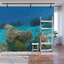 3 clownfish in a green anemone Wall Mural