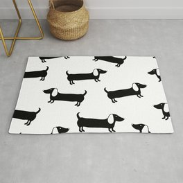 Cute dachshunds in black and white Rug