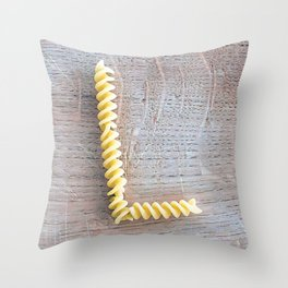 Letter L composed with pasta fusilli on a wooden chopping board Throw Pillow