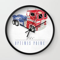 optimus prime Wall Clocks featuring The Optimus Prime by Josh Ln