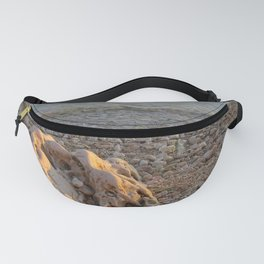 Rock between stones and pebbles by the sea of Croatia Fanny Pack