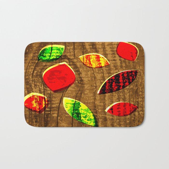colored leafs on wood Bath Mat