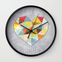 home sweet home Wall Clocks featuring Home Sweet Home by cafelab