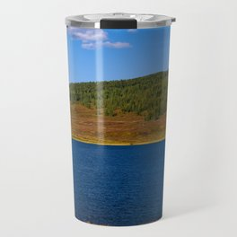 Calm water pond with greenery on mountain in background Travel Mug