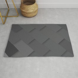 Grey/gray pattern, layered like shingles, tiles or those paint swatches you just cannot choose from! Rug