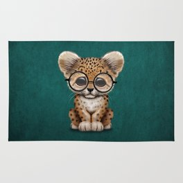 Cute Baby Leopard Cub Wearing Glasses on Teal Blue Rug