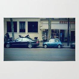 Parking in Paris isn't so hard...when you've got a tiny car! Rug