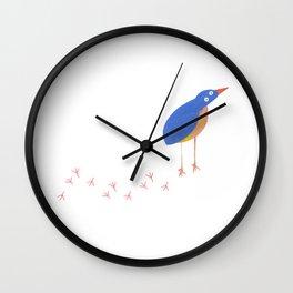 Bird leaving a trail Wall Clock