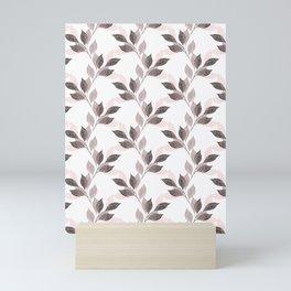 Pink, black leaves on a white background. Mini Art Print