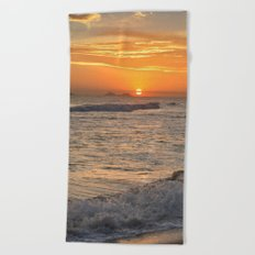 Sunset with crashing waves Beach Towel