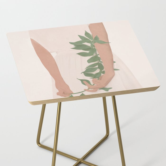 Holding on to a Branch Side Table